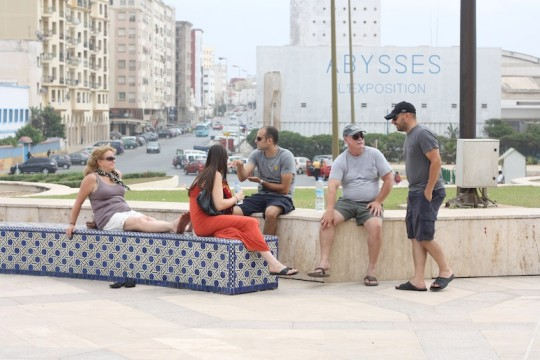 Sitting outside the Hassan II Mosque, Casablanca, Morocco.