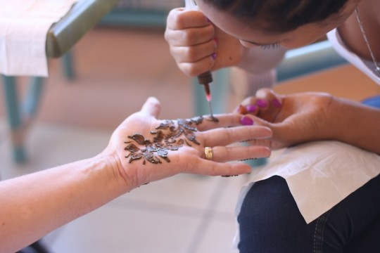 Henna treatments on our hands and feet before the wedding.