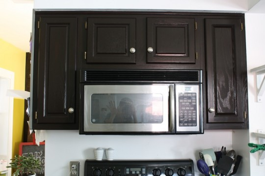 Refinished kitchen cabinets make appliances blend right in.