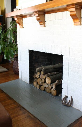 Wham bam – real logs immediately improve the looks of our fireplace.