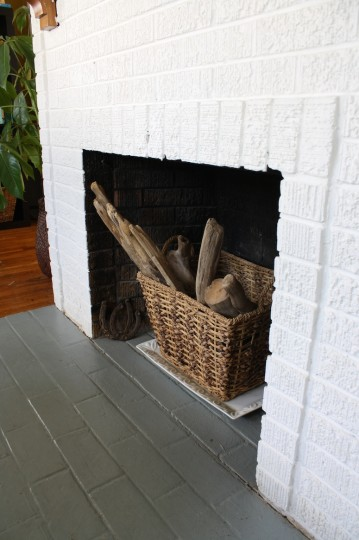 Time to get this basket of driftwood out of our prime fireplace real estate.