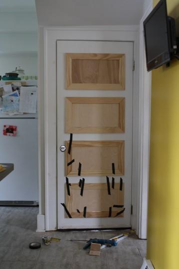 Making over the basement door with DIY panels.