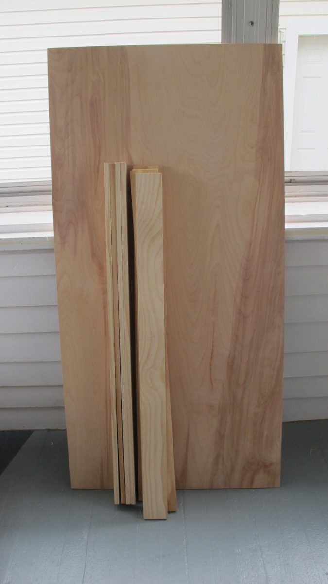 "I used a birch 2x4x1/8"" panel and twelve 3""x36""x1/2"" craft boards for <$35 to update our basement door."