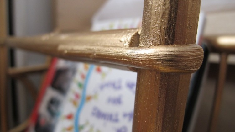 Bentwood magazine rack in gold.