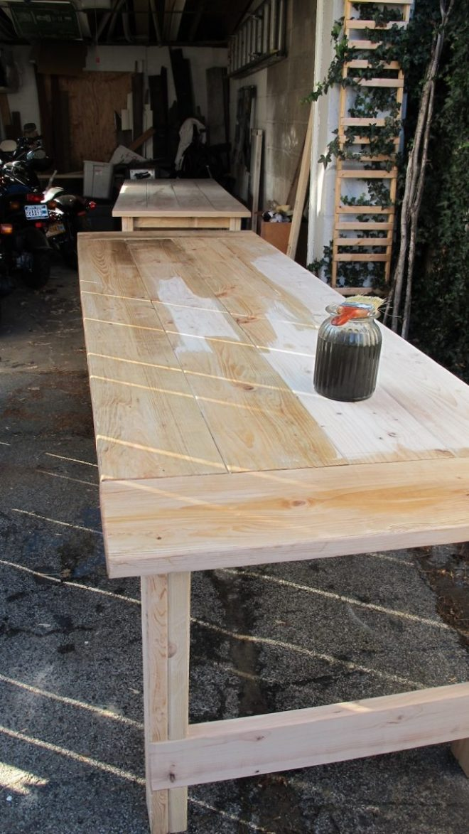 Staining the wedding tables using a natural stain.