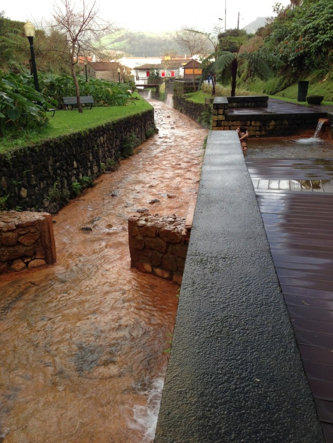 Hot spring diverting into pools in Furnas, Azores.