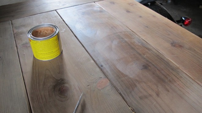 Waxing our DIY pine tables.