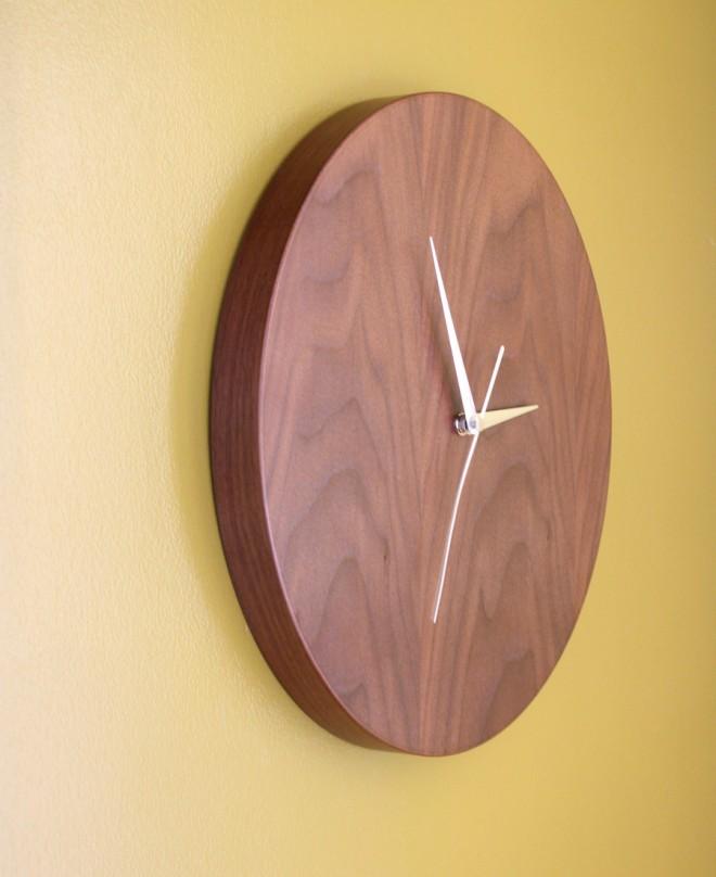 Walnut clock sits flush against the wall.