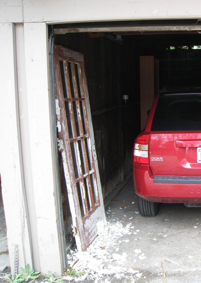 Rehabbing a broken paned door in my apartment garage.