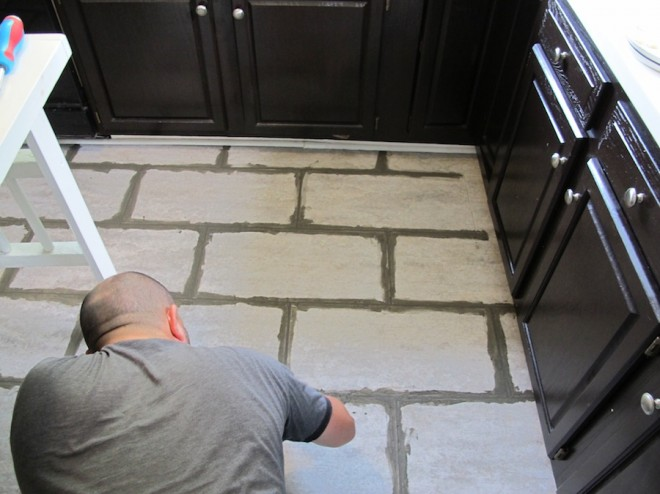New grout needed between our kitchen floor tiles.