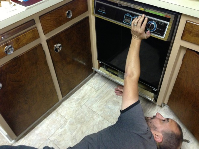 Self-removal of the old dishwasher.