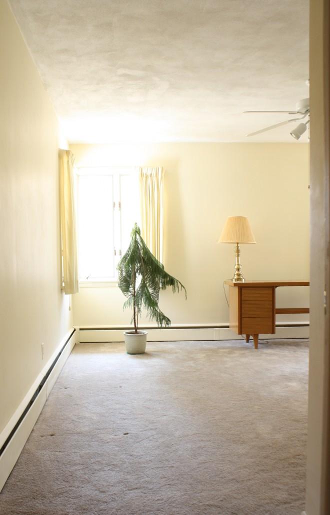 Bedroom with corner windows.