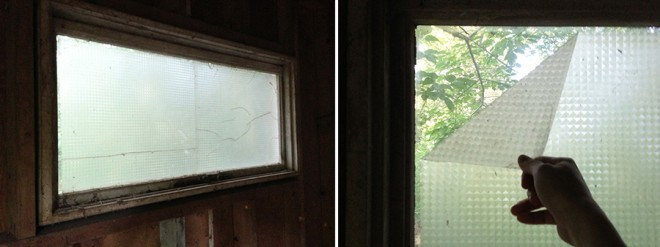 Barn windows covered by privacy adhesive covering.