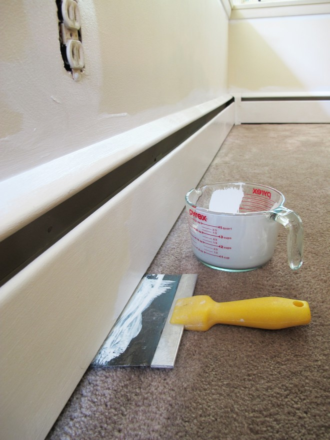 Prepping the baseboards with primer.