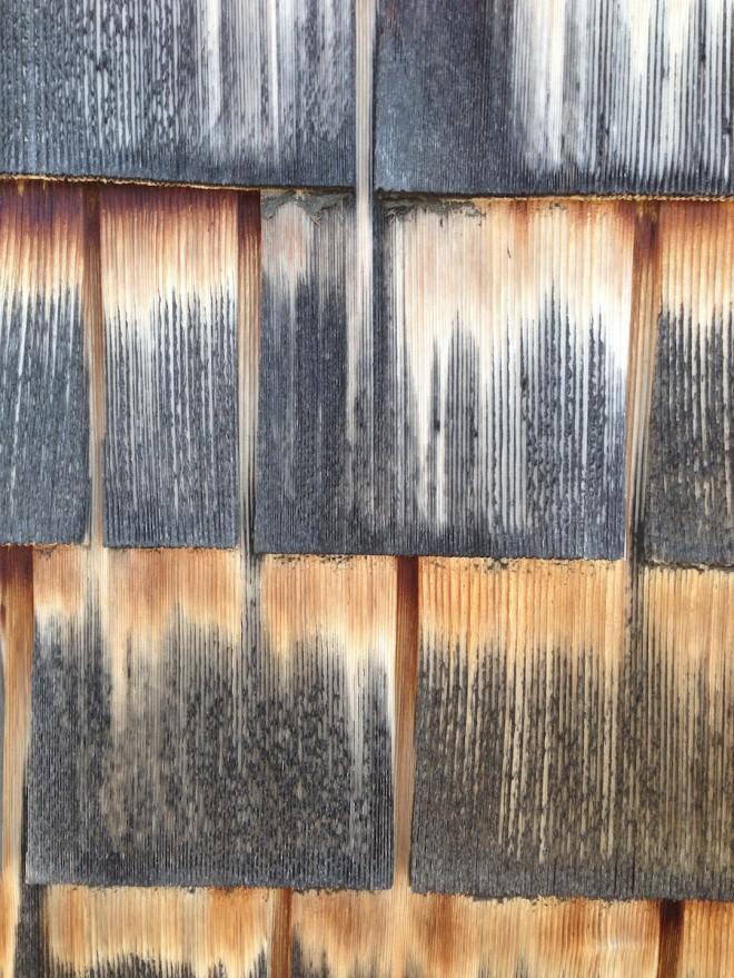 Faux weathered treatment on cedar shingles on the Boldt Boat House, Thousand Islands, NY.