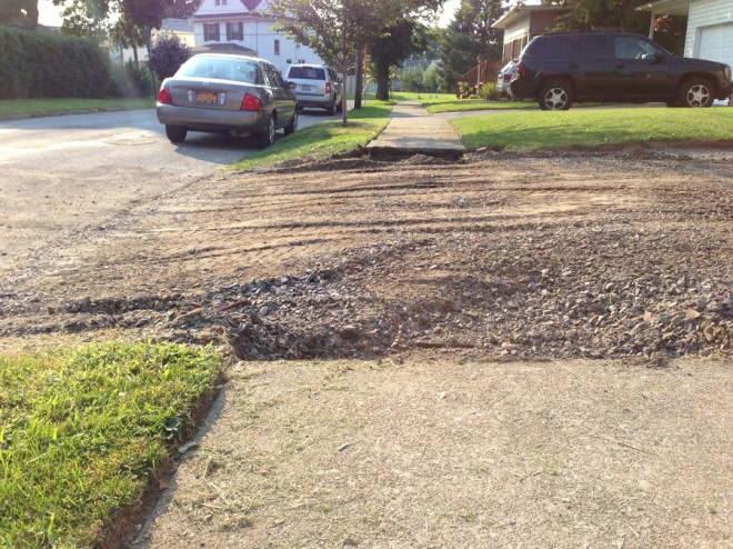 Smoothing out the entry for the driveway.