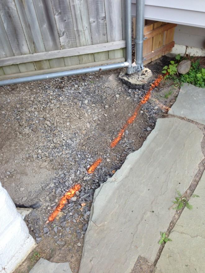 Marking the asphalt borders in the backyard.