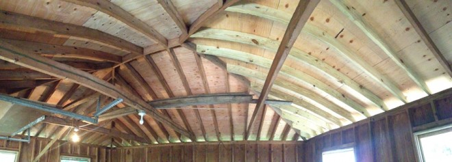 A panorama of the inside of of newly roofed barn