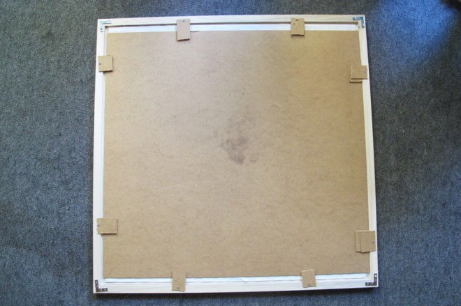 Recycled backer board for this large frame.