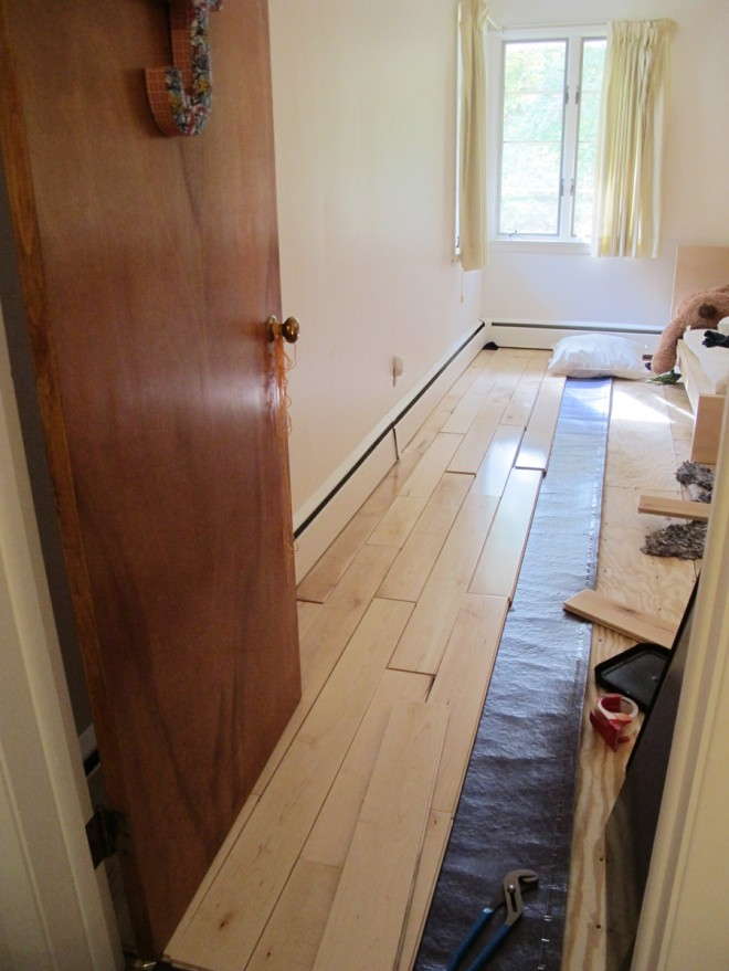 Finishing up my weekend by racking floorboards in Julia's room.