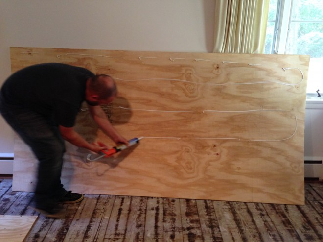 Installing the hardwood floor underlayment.