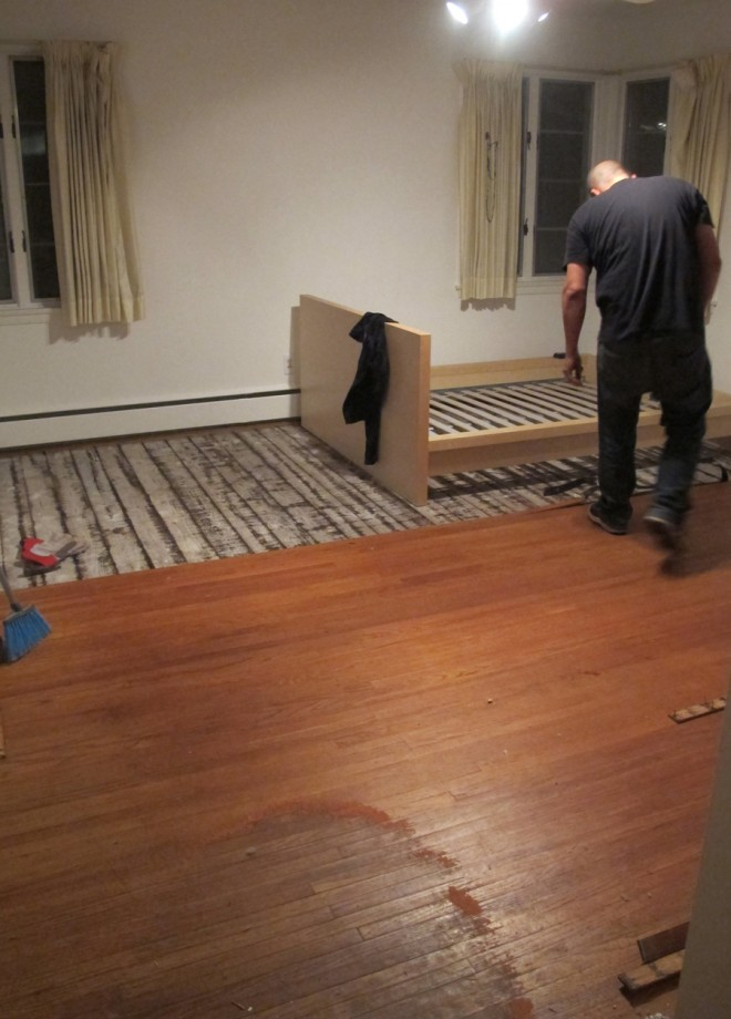 Removing hardwood flooring from Julia's room.