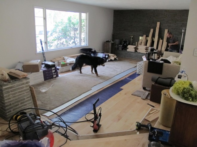Installing flooring in the living room.