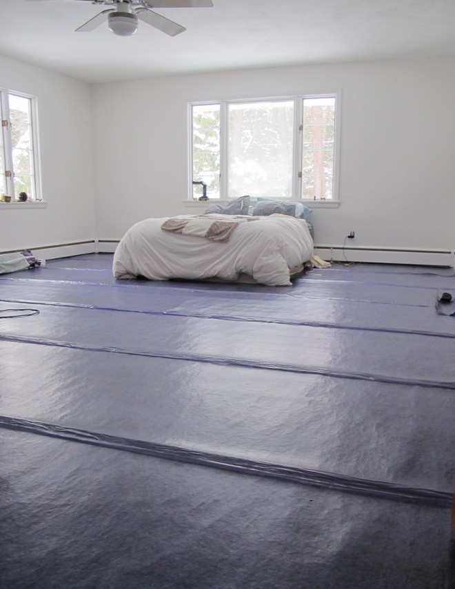 Installation of the underlayment to go beneath our new maple floors in the bedroom.