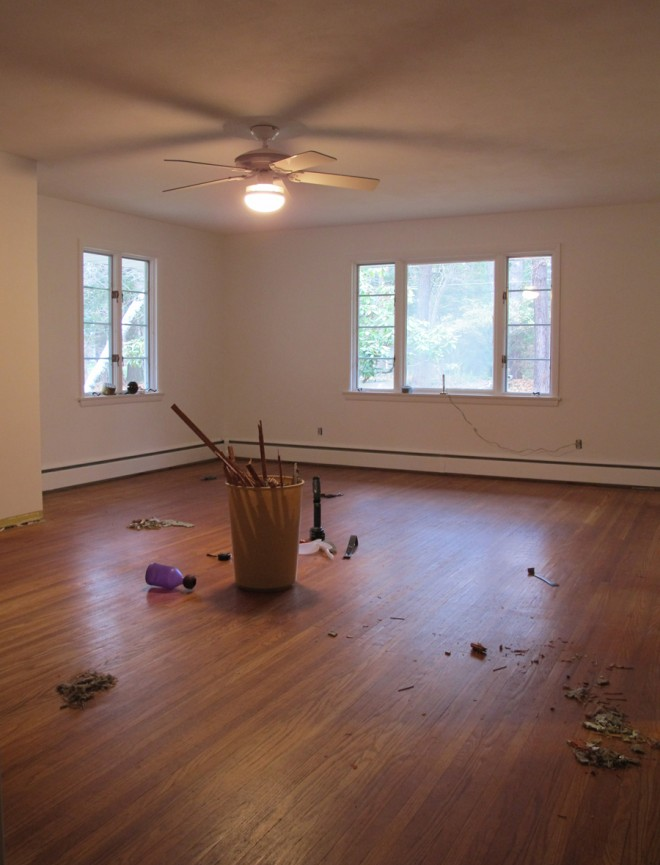 Carpet removed, oak flooring exposed in the bedroom.