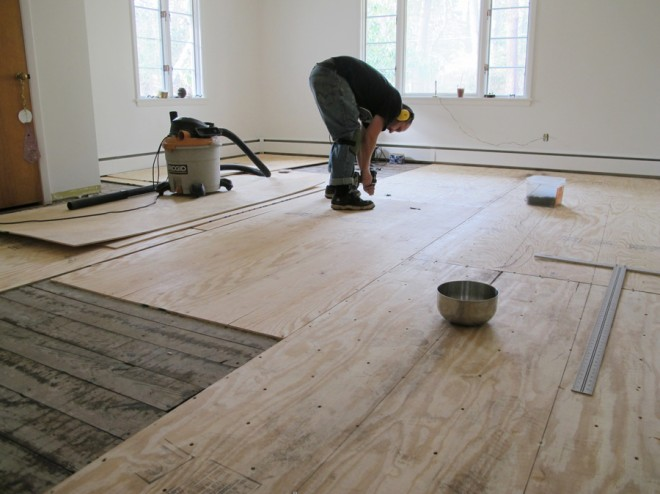 Installing all of the plywood over the existing subfloor.