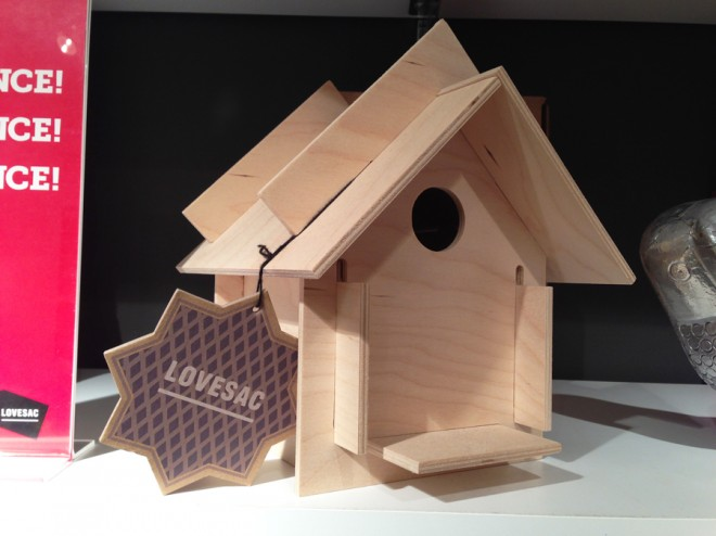 Traditional light wood birdhouse from Lovesac.