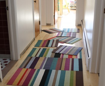 Organizing our new FLOR carpet tiles as a rainbow runner.