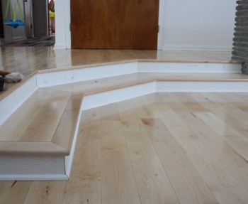 Finished stairs in beautiful maple, with clean, white trim.