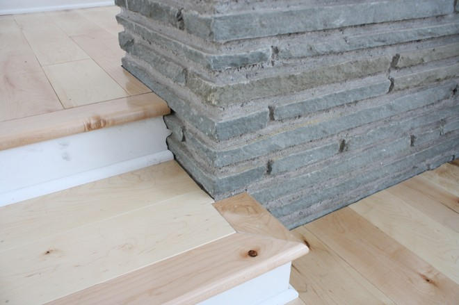 Detailed floorboard cuts next to a flagstone planter.