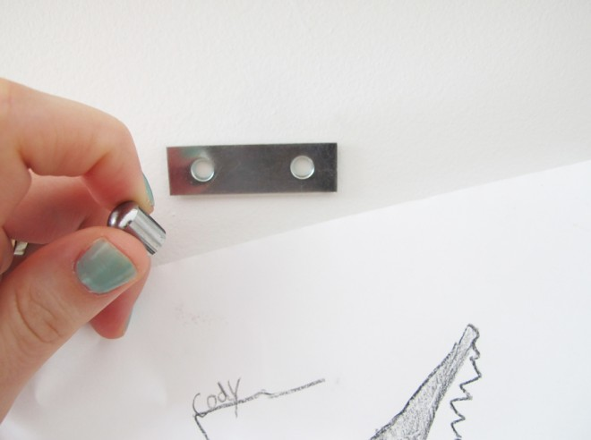 Hanging images in a gallery wall using magnets.
