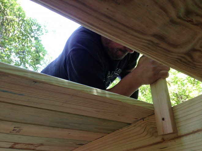 One man's job: attaching deck boards.