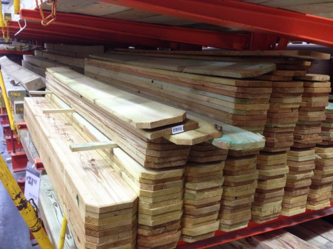 Buying fence boards at Home Depot to cut and make into a treehouse railing.