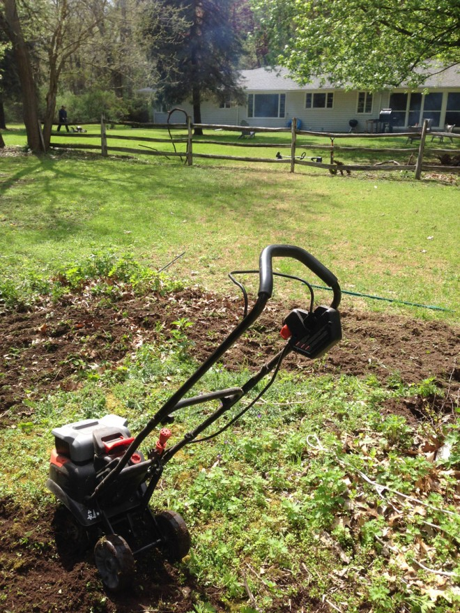 Creating a round garden bed using a rototiller.