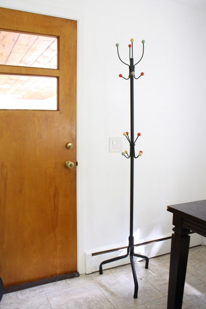 Eames-inspired coat rack with round beads.