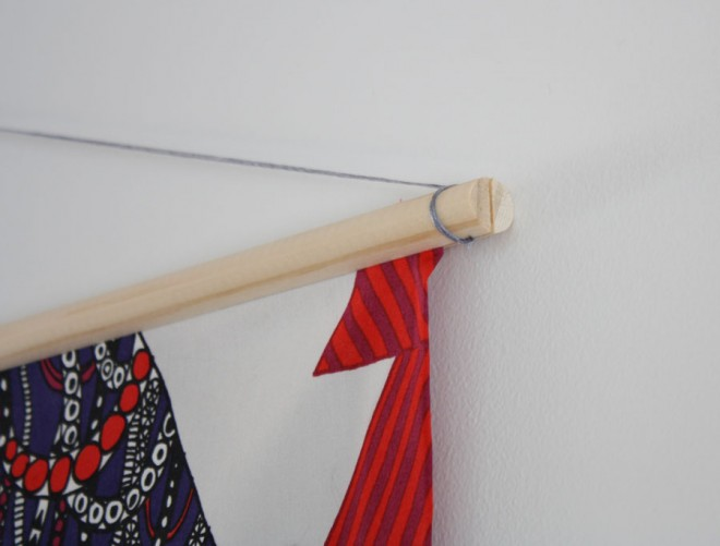How to make and hang a DIY wall tapestry using fabric and moulding.