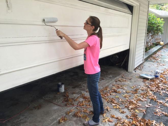 Priming the wooden garage door.