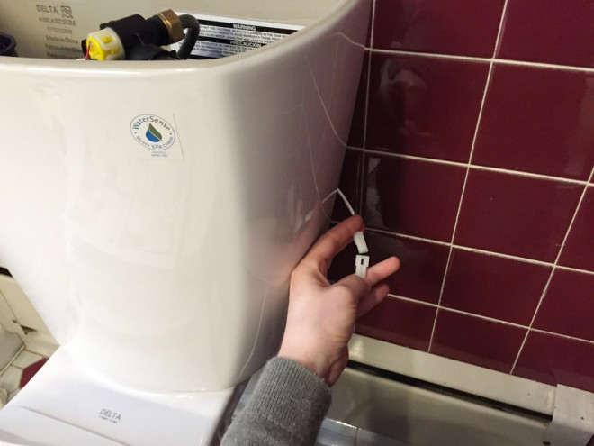 No touch flush Delta toilet electronics.