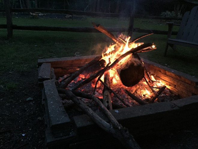 Spring campfire in the backyard in a flagstone fire pit.