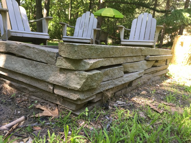 Build a loose stone flagstone fire pit.