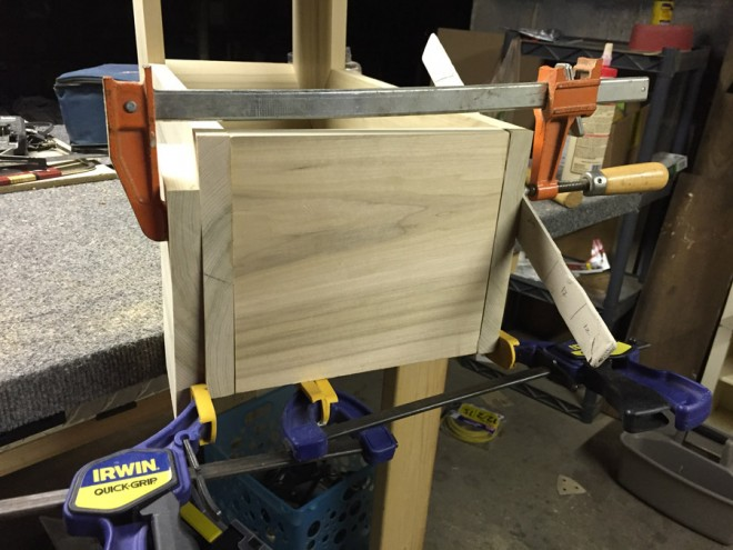 Clamp a shelf together if using wood glue, biscuits, and no screws.