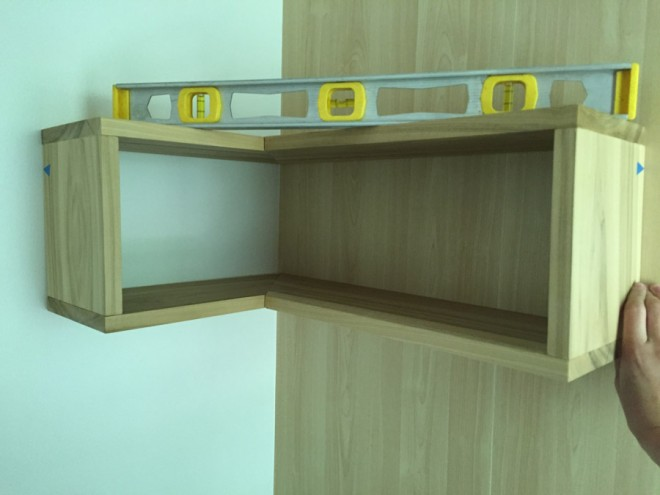 Install the shelf on pins first to ensure level.
