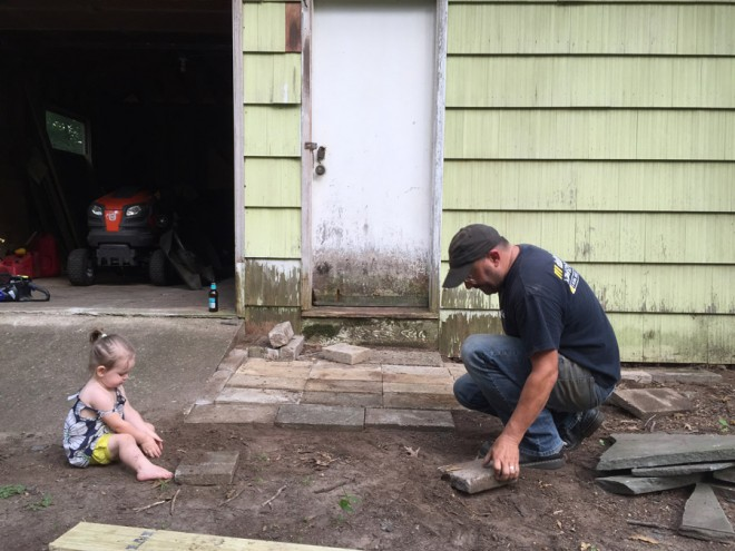 Making an entryway to our barn using cement pavers.