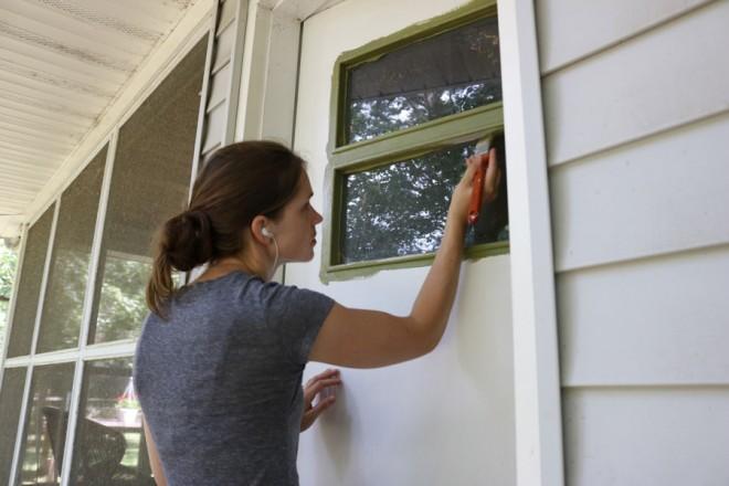 Paint the details around the windows in the door.