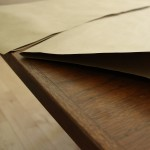 Cut kraft paper to fit in window, fold it in half.