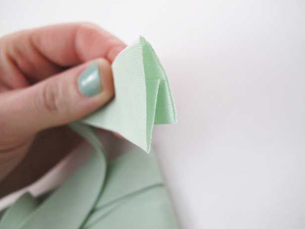 How to tie a custom bow clips to dress up plain shoes.